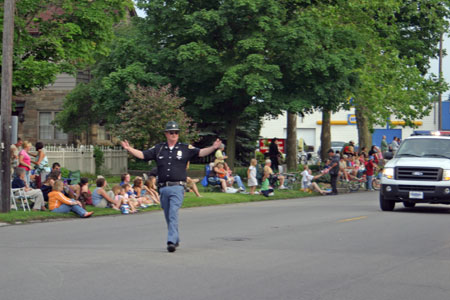 Denny Reichard leading the parade in Rochester, IN